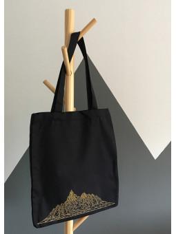 Czarna torba ze złotymi górami