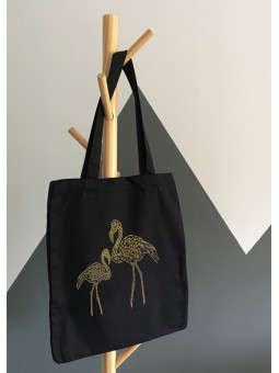 Czarna torba ze złotymi...